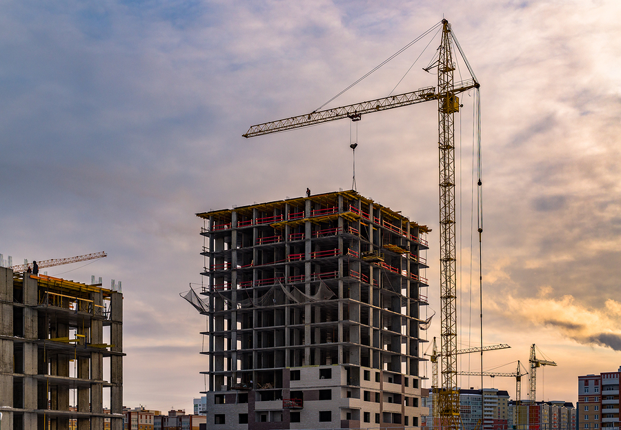 Building Crane And Building Under Construction. Construction Sit